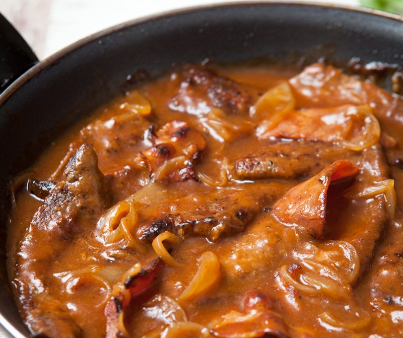 cooking meat with tomato puree