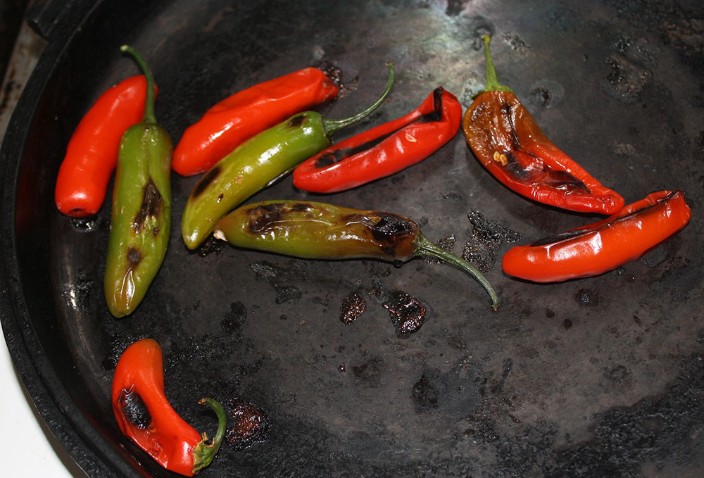 roast peppers in a comal or pan