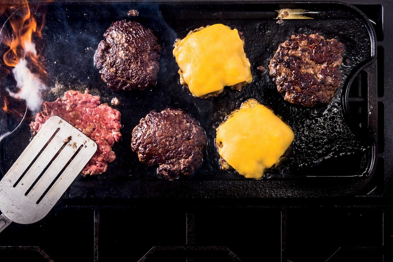 cooking the steak with bread and cheese