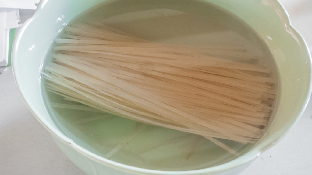 cooking and draining rice noodles