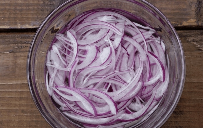 Put the onions in salted water